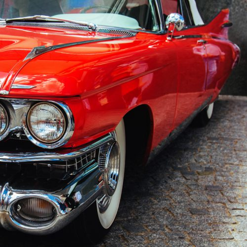 Antique vintage retro red automobile american car front light