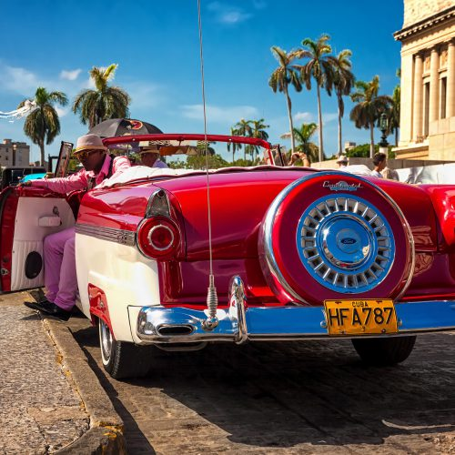 HAVANA-AUGUST 14:Classic Ford waiting for tourists near the Capitol August 14,2012 in Havana.These old cars are an attraction for the more than 2 million people who come to the island every year