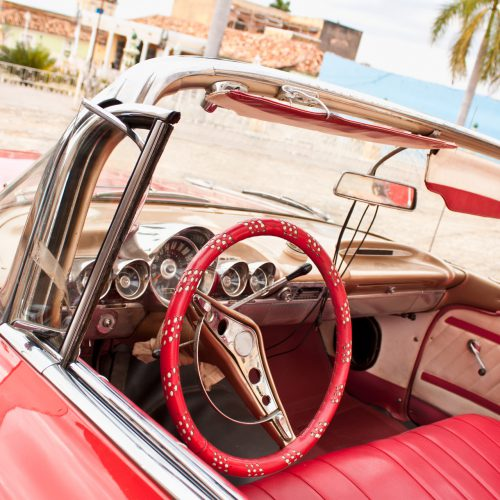 Detail of  Red Classic Chevrolet in the central square of Trinidad, Cuba.